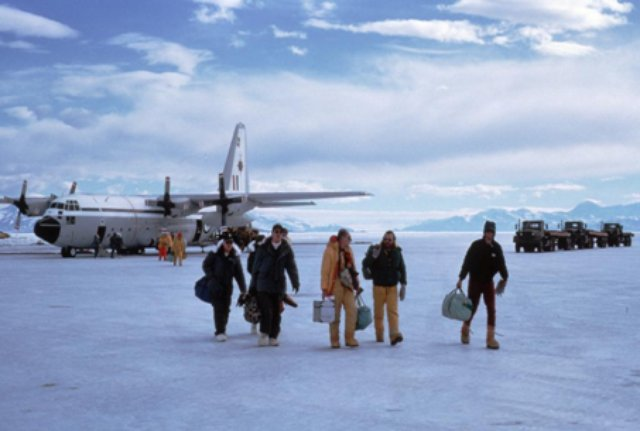 People dismounting a plane in Antarctica.